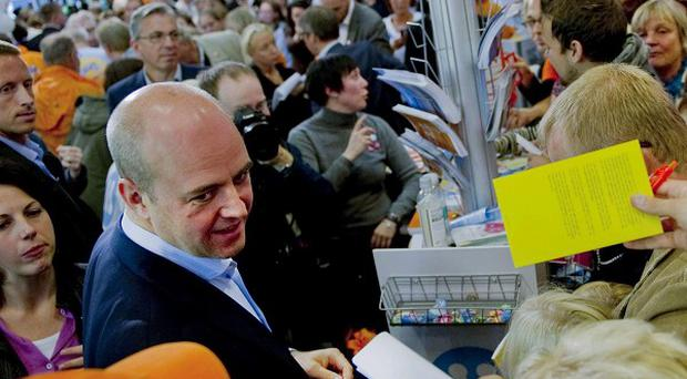 Swedish PM Fredrik Reinfeldt is surrounded by supporters at a shopping mall in Gothernburg (AP)