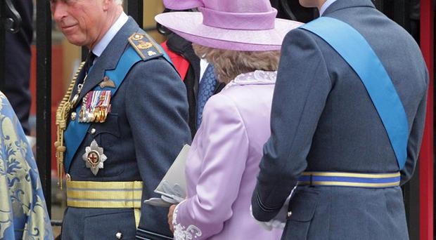 The Prince of Wales, The Duchess of Cornwall and Prince William arrive for the Battle of Britain service