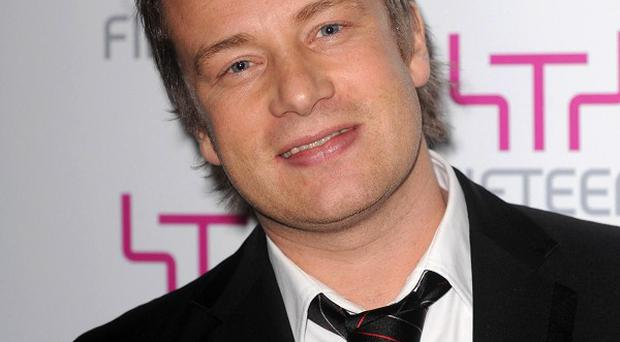 Jamie Oliver has said looming spending cuts could threaten his pioneering centre