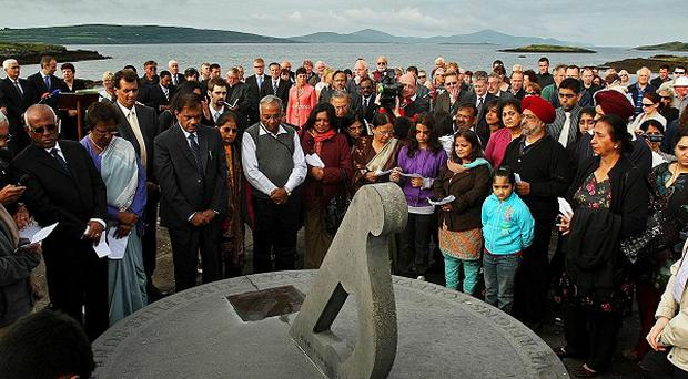Relatives of the 1985 Air India bombing along with Irish, Indian and Canadian ministers gather at the memorial in west Cork, Ireland