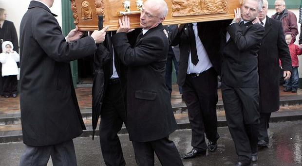 The coffin of Charlie Armstrong, one of the 'Disappeared' during the troubles, is carried into St Patrick's Church in Crossmaglen