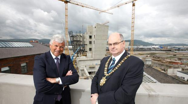 The developer of the Titanic Quarter and Belfast City Council have formed a partnership to make the most of opportunities arising from the 185-acre development. Mike Smith, Titanic Quarter chief executive, and Pat Convery, SDLP Lord Mayor of Belfast, launched the scheme as building progresses on the dramatic Titanic Signature Project in the background