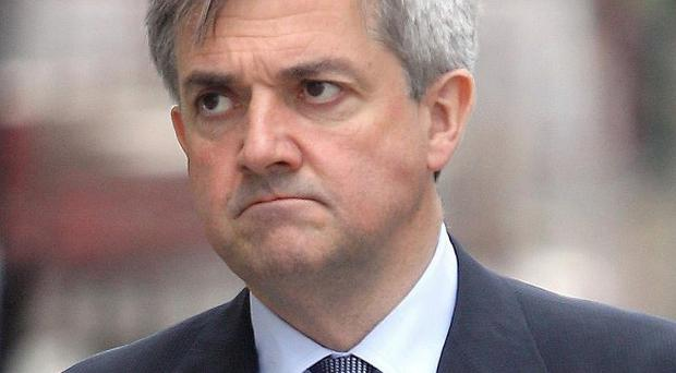 Chris Huhne has issued a warning to energy firms over 'outrageous' hidden price hikes