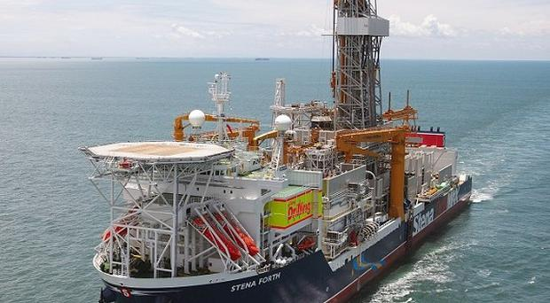 Cairn Energy said it had discovered gas and two types of oil off the coast of Greenland