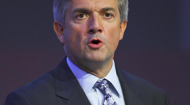 A plan to create almost 250,000 jobs in green industries will offset budget cuts, Chris Huhne said