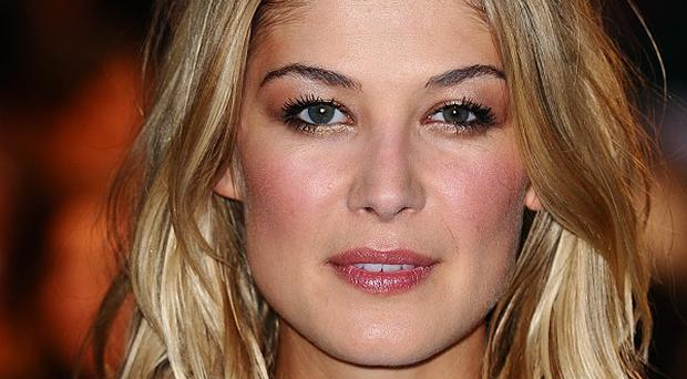 Rosamund Pike thinks attractive women are sometimes offered boring roles