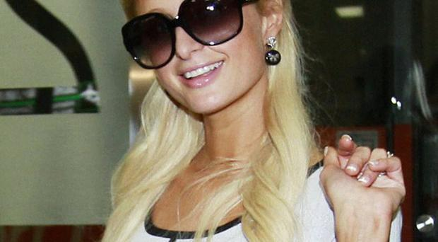 Japanese officials have kept Paris Hilton at Narita International Airport for a second day
