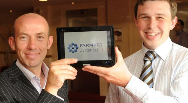 Alastair Higgins, Invest NI, with George Brownlee of Farmvet Systems in Magherafelt.