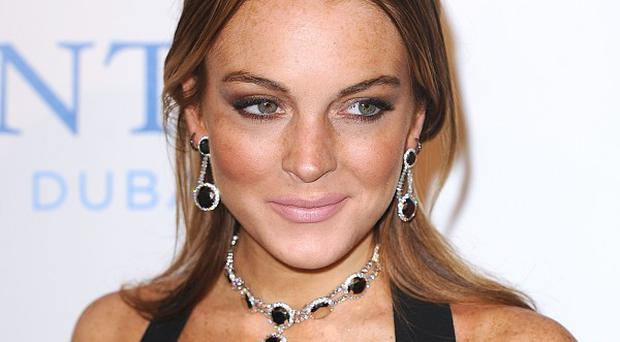 An arrest warrant has been issued for Lindsay Lohan over failed drugs test