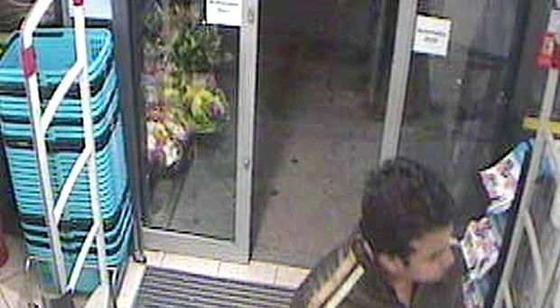 CCTV image of a man detectives wish to speak to in connection with the murder of Michelle Samaraweera