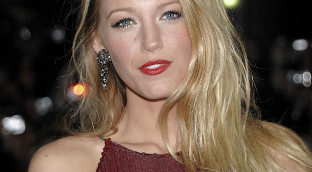Blake Lively sports a different look for The Town