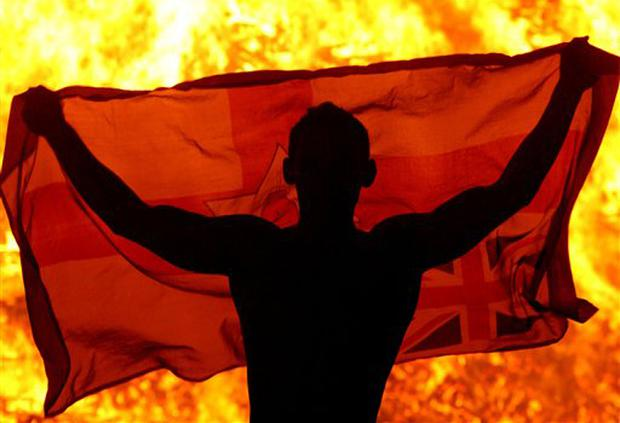 Youth watches a bonfire on the Shankill Road area of west Belfast, Northern Ireland