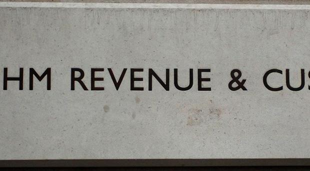 HM Revenue and Customs has denied it planned to write off more than 1.5 billion pounds of unpaid tax