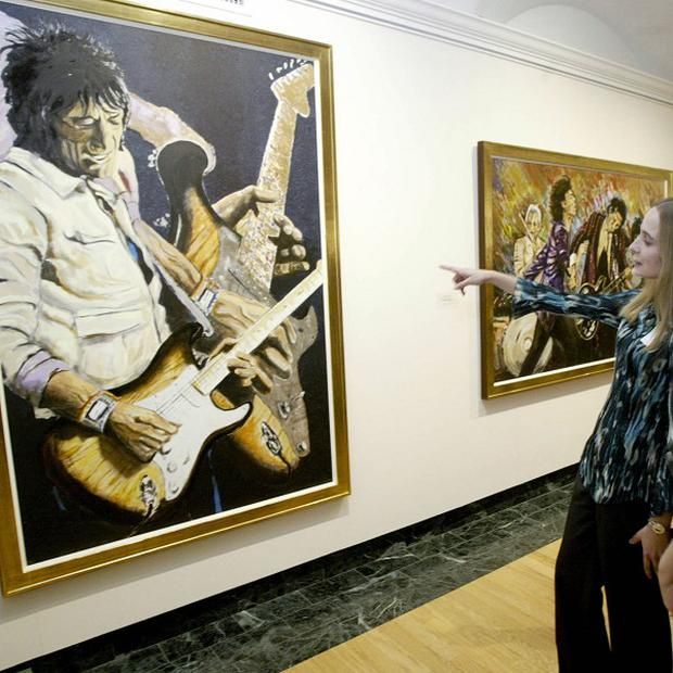 Ronnie Wood is pleased his artwork is being shown at a galleru