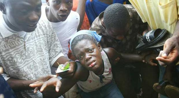 Blood and fear: a Liberian woman beaten by soldiers