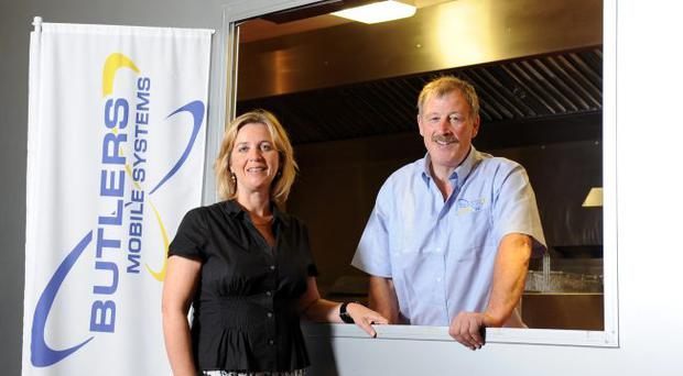 Carol Keery, innovation director at Invest NI, and Patrick Butler, owner of Butler Mobile Systems, discuss the firm's new mobile kitchen unit created with the support of the development agency.