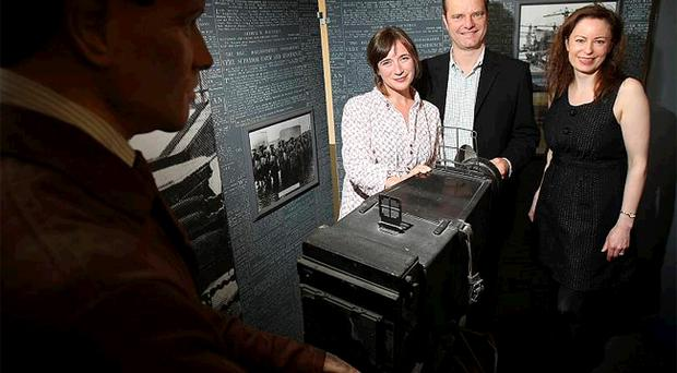 Kresanna Aigner (left) from Culture Belfast 2010, Belfast Telegraph editor Mike Gilson and deputy editor Gail Walker help launch a display showing an old newspaper photographic studio which will be on show in the Telegraph building on Belfast Culture Night