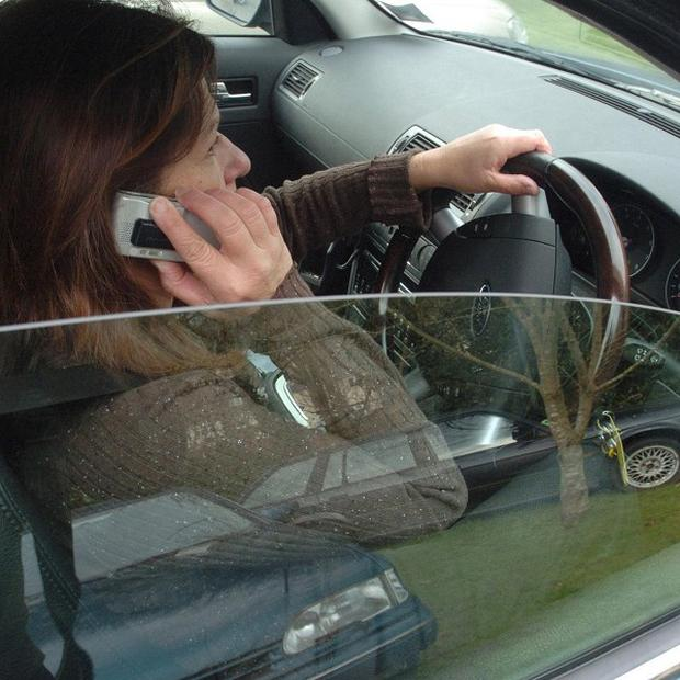 Drivers 'risking their lives' by using hand-held mobile phones
