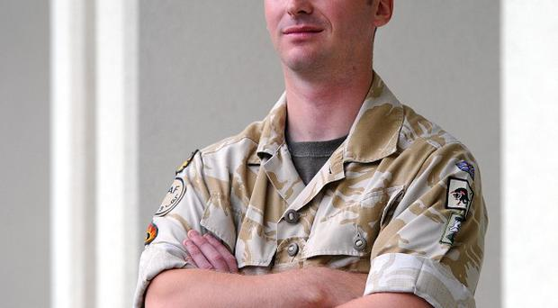 Sergeant Karl Ley is to receive the George Medal for his work clearing roadside bombs
