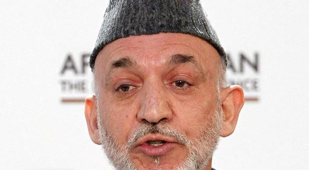 Afghan President Hamid Karzai called for the journalists to be freed