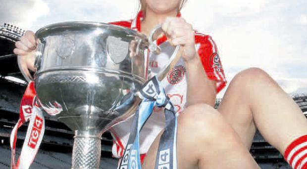 Hands on: Tyrone Ladies captain Sinead McLaughlin is hoping she'll take the All-Ireland Senior trophy away from Croke Park tomorrow afternoon by beating the Dubs in the final