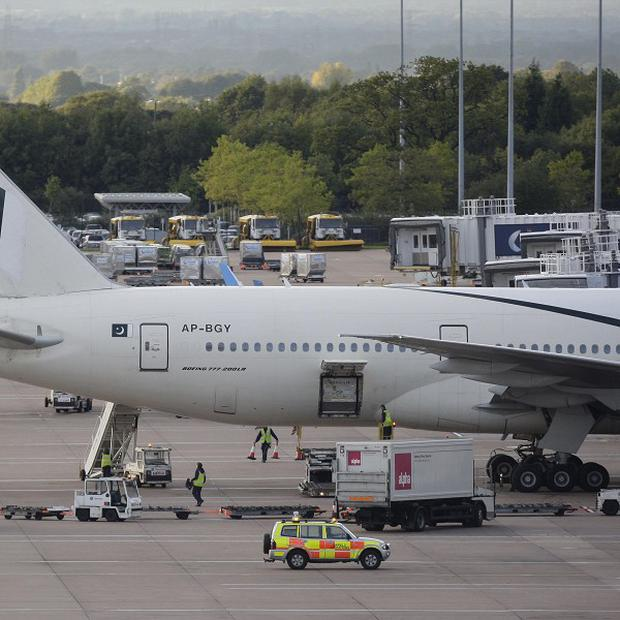The Pakistan International Airlines plane at Manchester Airport after it was held in Sweden following a bomb scare (AP)