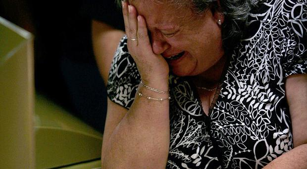A relative of Prisciliano Rodriguez, late mayor of the town of Doctor Gonzalez, reacts during his wake (AP)