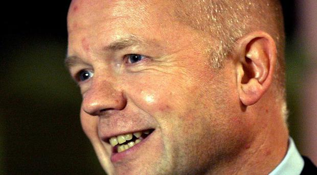 Foreign Secretary William Hague called on Israel to show restraint on settlement building
