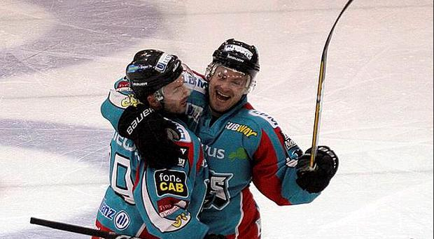 Colin Shields gets a hug from Dan Welch after breaking his scoring duck for the season in the Belfast Giants win over the Dundee Stars last night