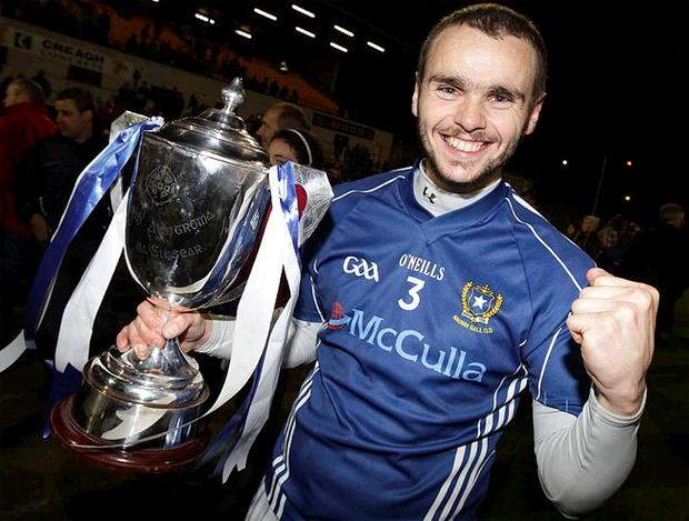 St Gall's captain Colin Brady proudly shows off the prize after his side saw off Cargin by 2-13 to 0-10 in Saturday night's Antrim SFC final at Casement
