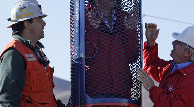 Mining minister Laurence Golborne stands inside a capsule that will be used to rescue trapped miners (AP)