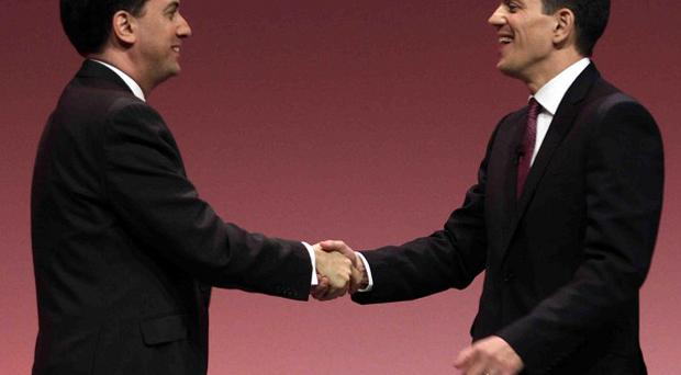 David Miliband, right, said he was 'incredibly proud' of his brother Ed, left
