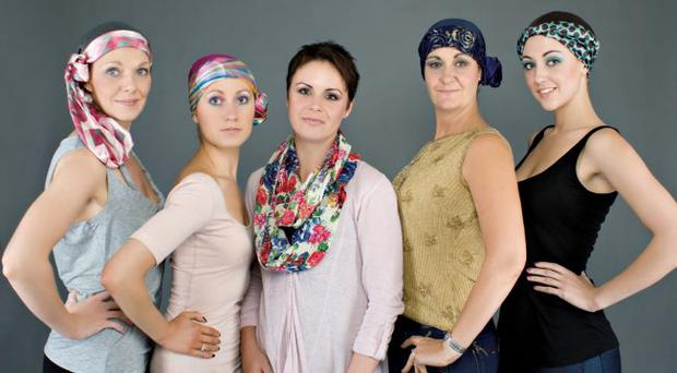 Ciara Priestly (centre) with models wearing a range of her headscarve designs