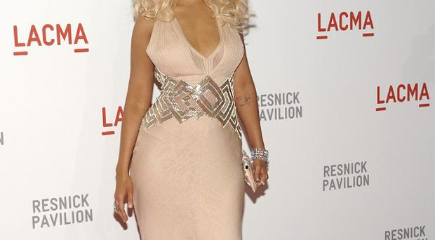 Christina Aguilera helped open an art exhibition hall with her performance