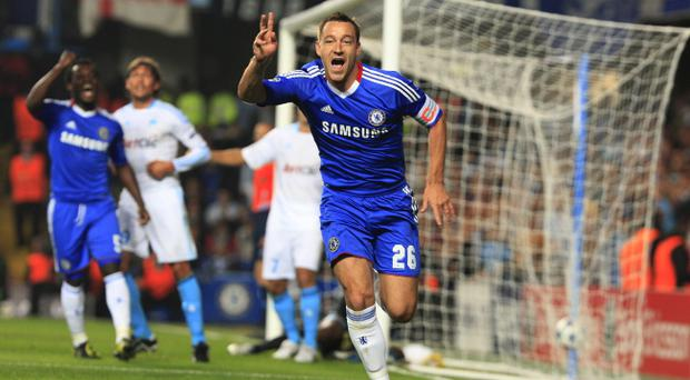 Chelsea's John Terry celebrates scoring the opening goal during the UEFA Champions League, Group F match at Stamford Bridge, London