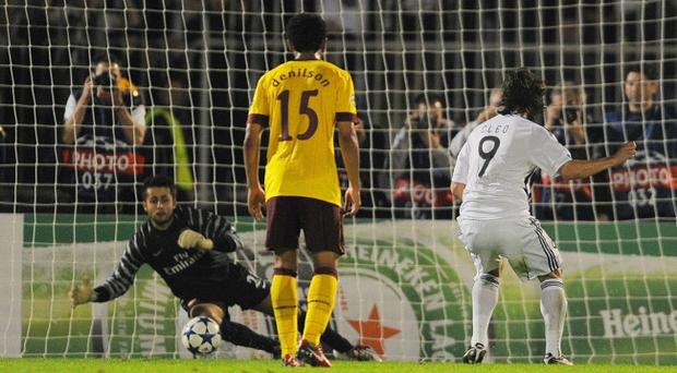 Goalkeeper Lukasz Fabianski of Arsenal saves a penalty from Cleo of Partizan during the UEFA Champions League Group H match between FK Partizan and Arsenal at the Partizan Stadium on September 28, 2010 in Belgrade, Serbia