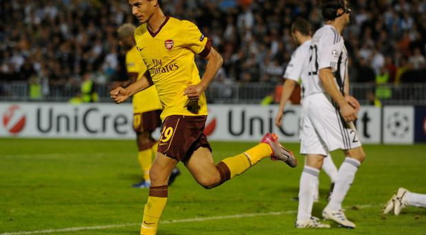 Marouane Chamakh of Arsenal celebrates after scoring during the UEFA Champions League Group H match between FK Partizan and Arsenal at the Partizan Stadium on September 28, 2010 in Belgrade, Serbia