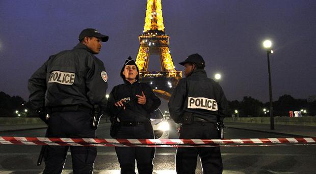 French police officers patrol near the Eiffel Tower in Paris (AP)
