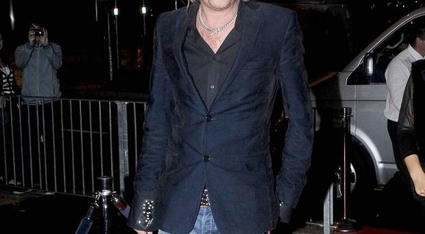 Rhys Ifans arrives on the red carpet at Cineworld, Cardiff, for the Welsh premiere of film Mr Nice