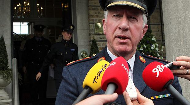 Garda Commissioner Fachtna Murphy speaks to reporters outside the Garda Officers Club