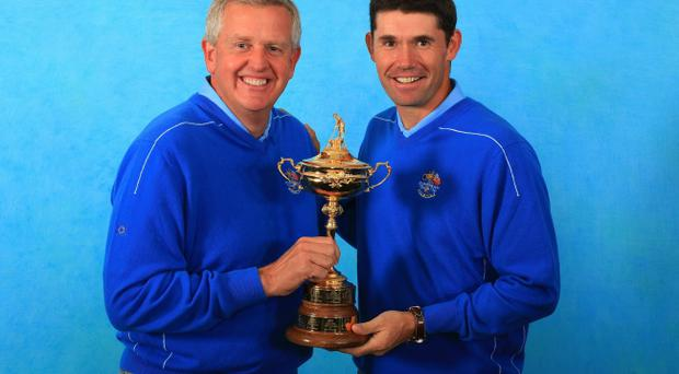 Europe Team Captain Colin Montgomerie poses with Padraig Harrington (R) and the trophy during the European Team Photocall prior to the 2010 Ryder Cup at the Celtic Manor Resort on September 29, 2010 in Newport, Wales