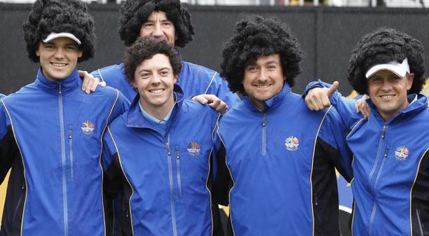Europe's team members Martin Kaymer, left, Graeme McDowell, second right, Luke Donald, right, and McIlroy's caddy John-Paul Fitzgerald, at rear, wear curly wigs similar to Rory McIlroy's hair, second left front, as a lighthearted joke during a practice round at the 2010 Ryder Cup golf tournament at the Celtic Manor golf course in Newport, Wales