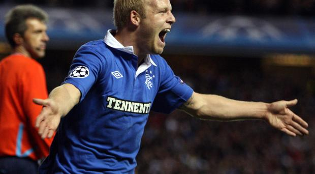 Rangers' Steven Naismith celebrates scoring his sides opening goal during the UEFA Champions League, Group C match at Ibrox Stadium, Glasgow