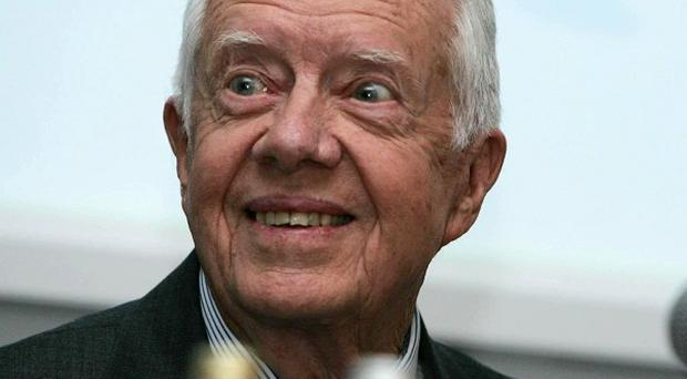 Former US president Jimmy Carter is to spend a second night in hospital
