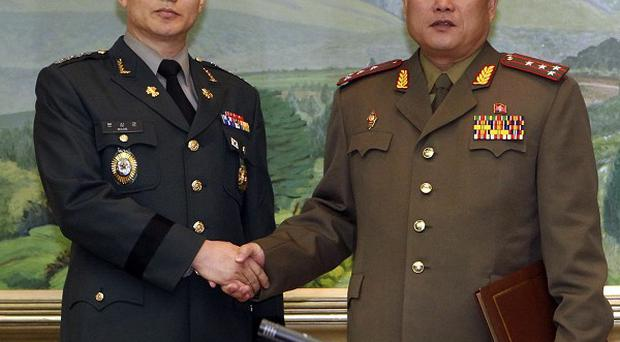 South Korean delegate Army Colonel Moon Sang-gyun, left, shakes hands with his North Korean counterpart Colonel Ri Sun Gyun (AP)