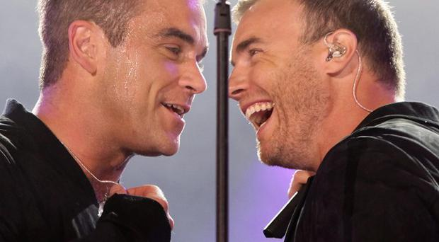 Robbie Williams and Gary Barlow buried their differences to reunite the original Take That line-up