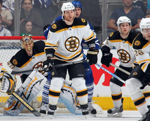 Dennis Wideman of the Boston Bruins defends on a penalty kill in a game against the Toronto Maple Leafs on April 3, 2010 at the Air Canada Centre in Toronto, Ontario.