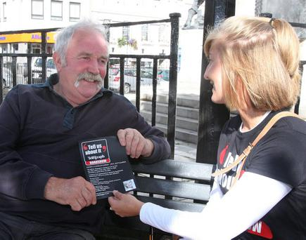 Belfast Telegraph reporter Lisa Smith, talking with John Black, at the Diamond in Londonderry.