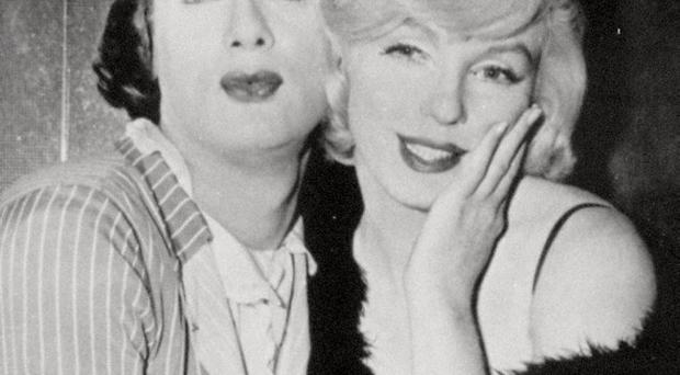 FILE - Tony Curtis and Marilyn Monroe in the hilarious milestone comedy, Some Like It Hot, produced, directed and co-scripted by Billy Wilder, United Artists, in this 1959 file photo. Curtis has died at 85 according to the Clark County, Nev. coroner. (AP Photo, File)