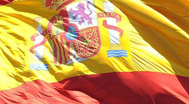 Moody's Investors Service has downgraded the Spanish government's debt
